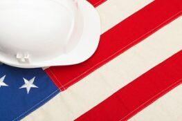 construction protective helmet laying USA flag