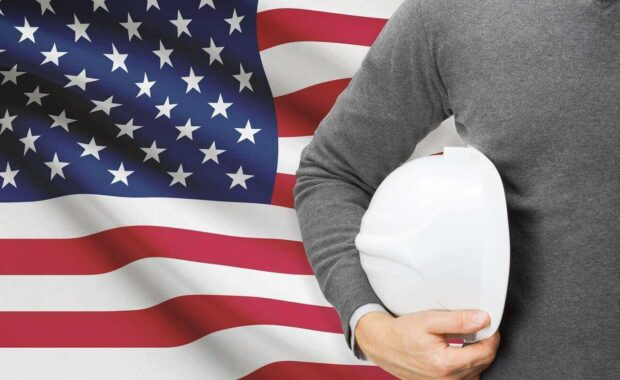 engineer with flag on background united states of america