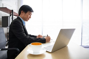 smart casual Asian senior director portrait in his workplace