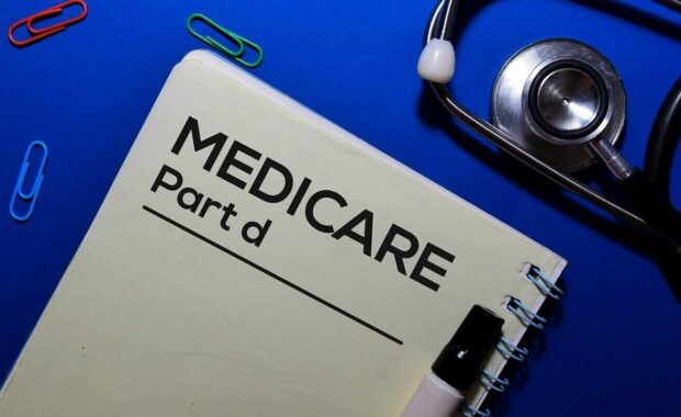 medicare part write on book isolated on wooden table