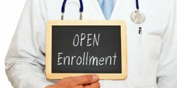 open enrollment doctor with chalkboard on white background