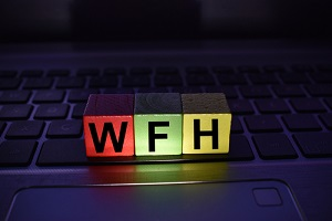 work from home on a colored wooden block on a laptop