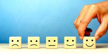 employee choosing smiley face on an employee survey